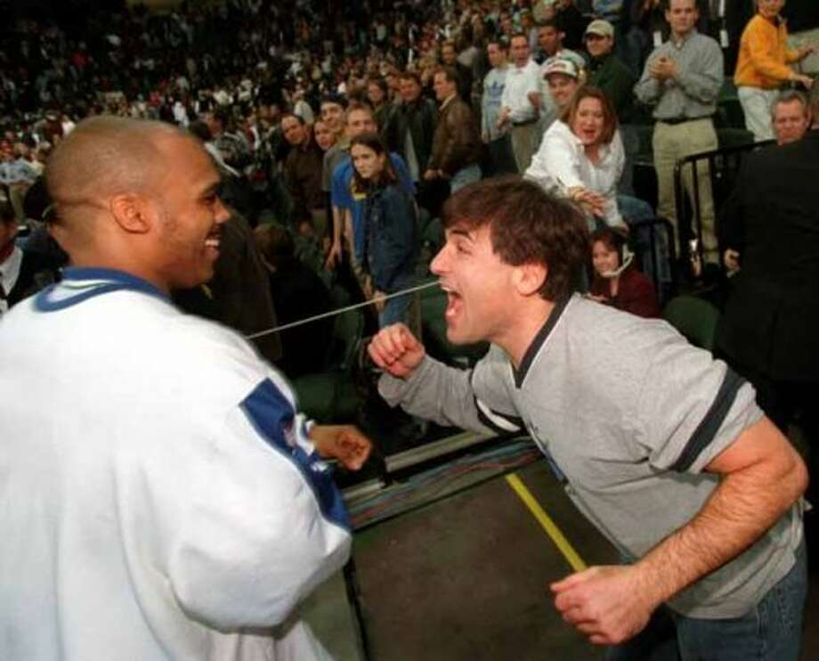 ADVANCE FOR THE WEEKEND OF DEC 23-25--Mark Cuban, owner of the Dallas Mavericks, congratulates the Mavericks' Gary Trent, left, after the Mavericks victory over the Portland Trailblazers at Reunion Arena in Dallas, Wednesday, Dec. 20, 2000.  After a revolving door of rebuilding attempts that seemed to make things worse instead of better, the Mavs are off to their best start in a dozen years and on pace to end the NBA's longest playoff drought. (AP Photo/The Dallas Morning News, Huy Nguyen) (HUY NGUYEN / AP)