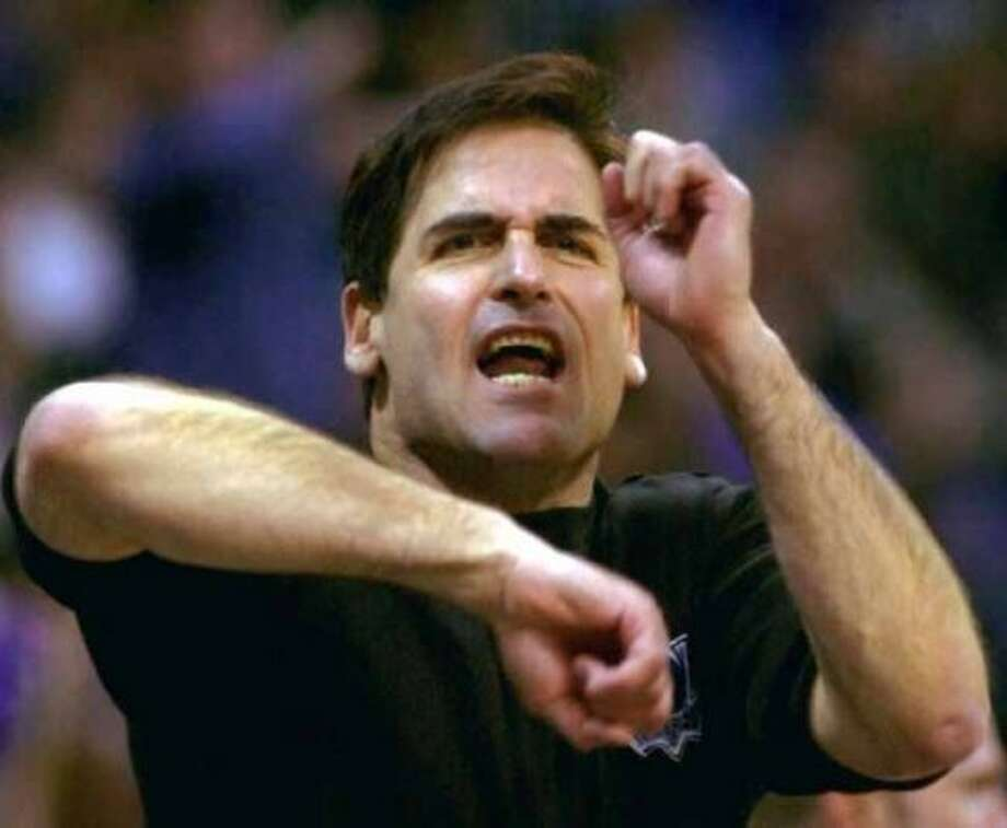 Dallas Mavericks owner Mark Cuban yells and signals a traveling penalty during the fourth quarter of the Kings' 116-105 win in Dallas, Monday, Jan. 15, 2001. (AP Photo/Bill Janscha) (BILL JANSCHA / Associated Press)