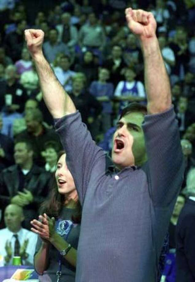 Dallas Mavericks owner Mark Cuban cheers the Mavericks at the start of the game against the Boston Celtics in Dallas, Thursday, Feb. 22, 2001. The game was Cuban's first game back from an NBA-imposed two-game suspension for dashing onto the court during a game.(AP Photo/Donna McWilliam) (DONNA MCWILLIAM / AP)