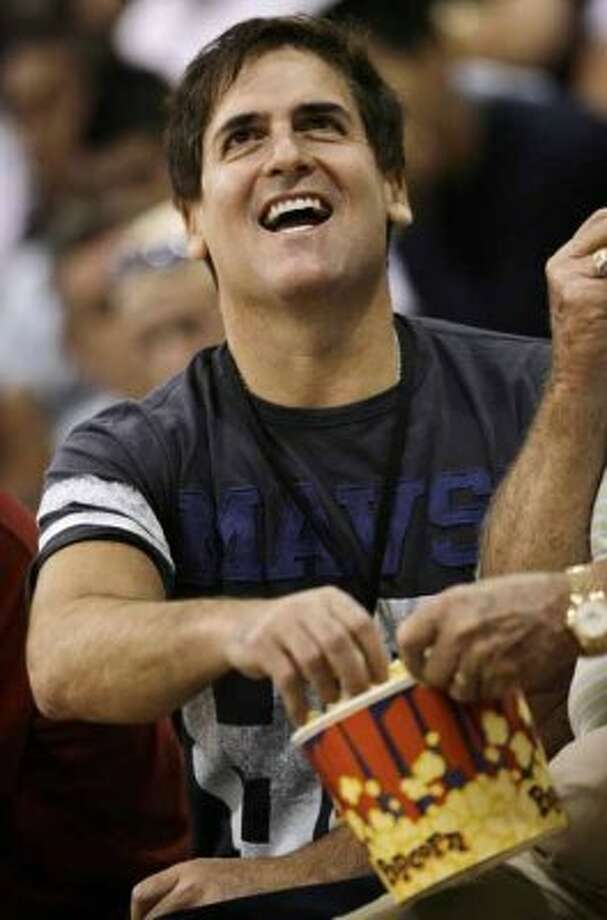 FILE -- This is a July 13, 2009, file photo showing Dallas Mavericks owner Mark Cuban looking at the scoreboard while eating popcorn and watching his team from the sidelines during an NBA summer league basketball game in Las Vegas.  (AP Photo/Laura Rauch, File) (Laura Rauch / AP)