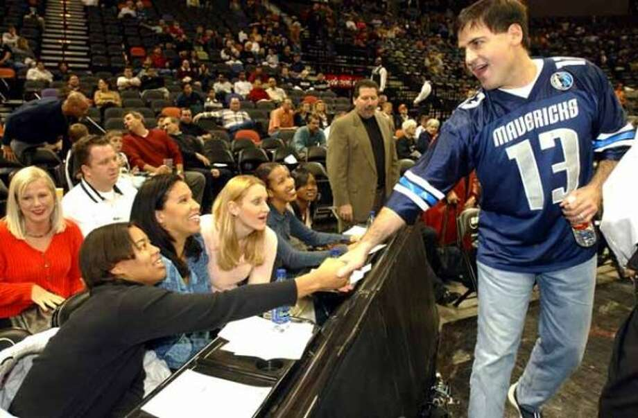 SPORTS - Dallas Mavericks owner Mark Cuban shakes hands with WNBA Utah Starzz players prior to the Mavericks game against the Spurs at the SBC Center on Wednesday, Dec. 11, 2002. Seated are: La'Neishea Caufield (left) Natalie Williams, Amy Herrig, LaTonya Johnson and Marie Ferdinand. ( JERRY LARA STAFF ) (JERRY LARA / SAN ANTONIO EXPRESS-NEWS)