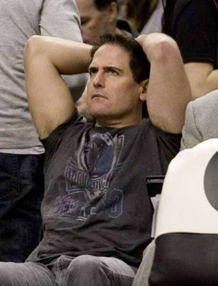 FILE - In this Jan. 17, 2010, file photo, Dallas Mavericks owner Mark Cuban reacts during his team's 110-88 loss to the Toronto Raptors during NBA basketball game action in Toronto.  federal appeals court has revived the Securities and Exchange Commission's insider-trading lawsuit against Dallas Mavericks owner Mark Cuban. The 5th U.S. Circuit Court of Appeals in New Orleans announced its ruling Tuesday, Sept. 21, 2010. (AP Photo/The Canadian Press, Chris Young, File) (Chris Young / AP)