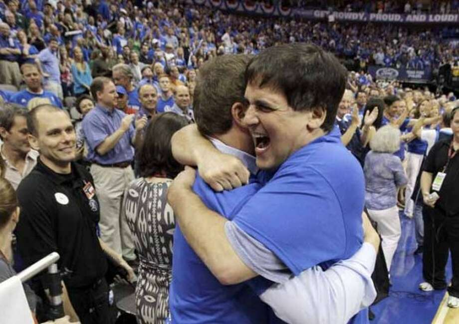 Dallas Mavericks owner Mark Cuban, right front, and business partner Todd R. Wagner embrace after the Mavericks defeated the Los Angeles Lakers 122-86 in Game 4 of a second-round NBA playoff basketball series, Sunday, May 8, 2011, in Dallas. The Mavericks swept the series. (AP Photo/Tony Gutierrez) (Tony Gutierrez / AP)