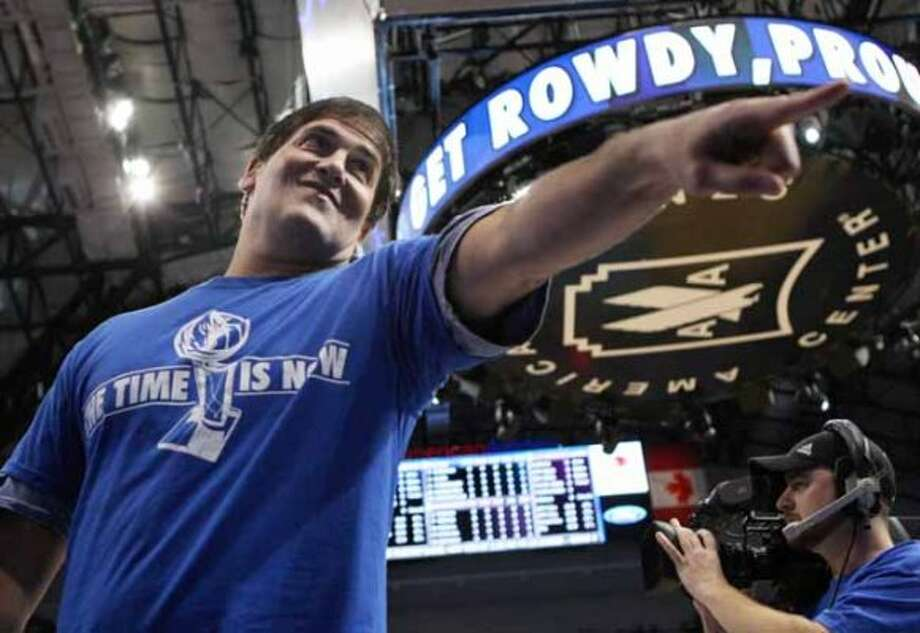 Dallas Mavericks owner Mark Cuban gestures before Game 3 of a second-round NBA playoff basketball series against the Los Angeles Lakers, Friday, May 6, 2011, in Dallas. (AP Photo/Kim Johnson Flodin) (Kim Johnson Flodin / AP)