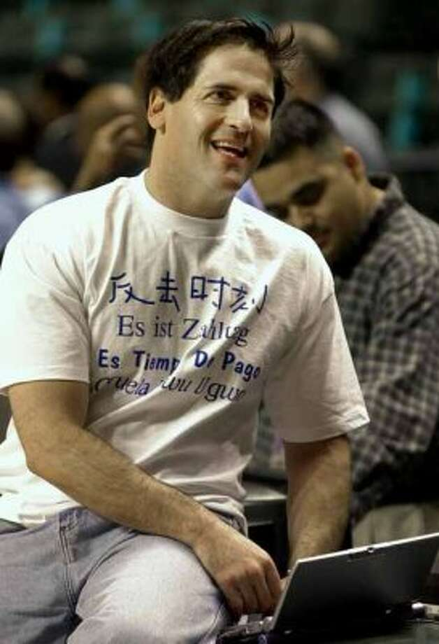 Dallas Mavericks owner Mark Cuban takes time from his laptop before the start of a game against the Minnesota Timberwolves in Dallas, Wednesday, April 18, 2001. (AP Photo/LM Otero) (LM OTERO / AP)