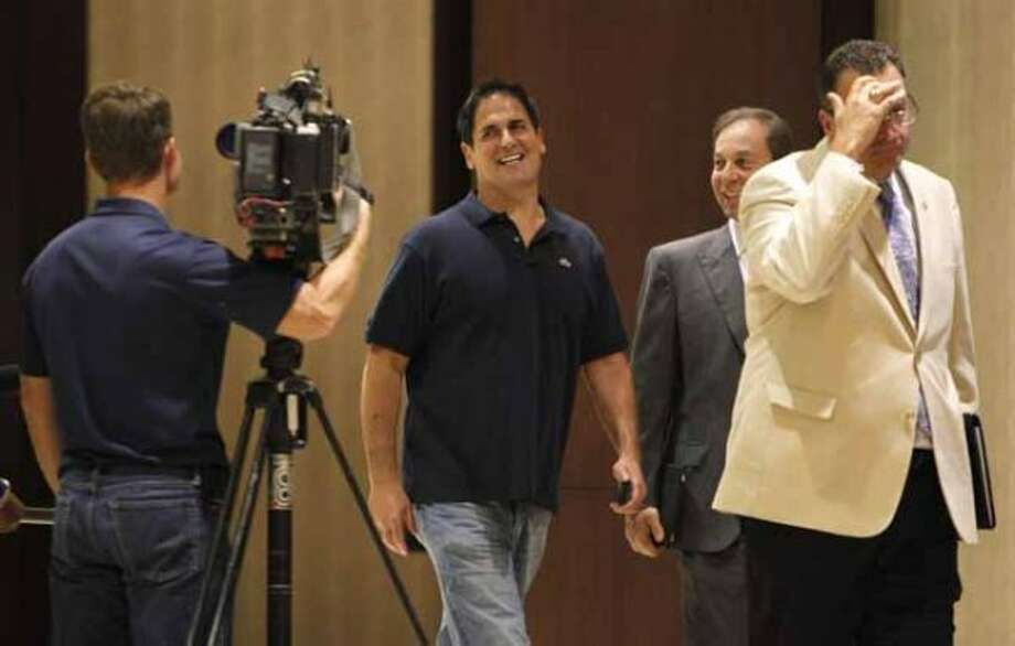 Dallas Mavericks owner Mark Cuban walks out of the NBA owners meeting without commenting to waiting media, in Dallas on Tuesday, June 28, 2011. (AP Photo/LM Otero) (LM Otero / AP)