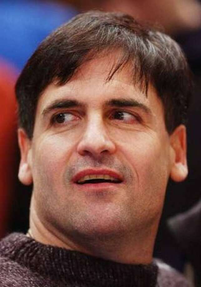 Dallas Mavericks owner Mark Cuban watches his team play the New York Knicks Friday, Jan. 24, 2003 in New York. (AP Photo/Mark Lennihan) (MARK LENNIHAN / AP)