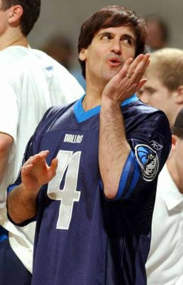Mavericks' owner Mark Cuban blows a kiss to fans during first half action against the Spurs game 1 Western Conference Finals at the the SBC Centerin San Antonio  Monday May 19, 2003. Edward A. Ornelas/Staff (EDWARD A. ORNELAS / SAN ANTONIO EXPRESS-NEWS)