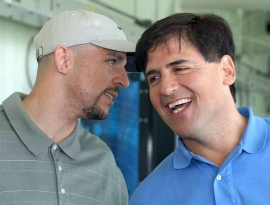 NBA superstar Jason Kidd, left, of the New Jersey Nets, laughs with Mark Cuban, owner of the Dallas Mavericks, Monday, June 23, 2003, in New York. Kidd and Cuban announced the upcoming American Century Golf Championship at Lake Tahoe, Nev., July 18-20. The event will benefit the Fallen Patriot Fund for families of Americans lost in the conflict in Iraq. (AP Photo/Ed Bailey) (AP)