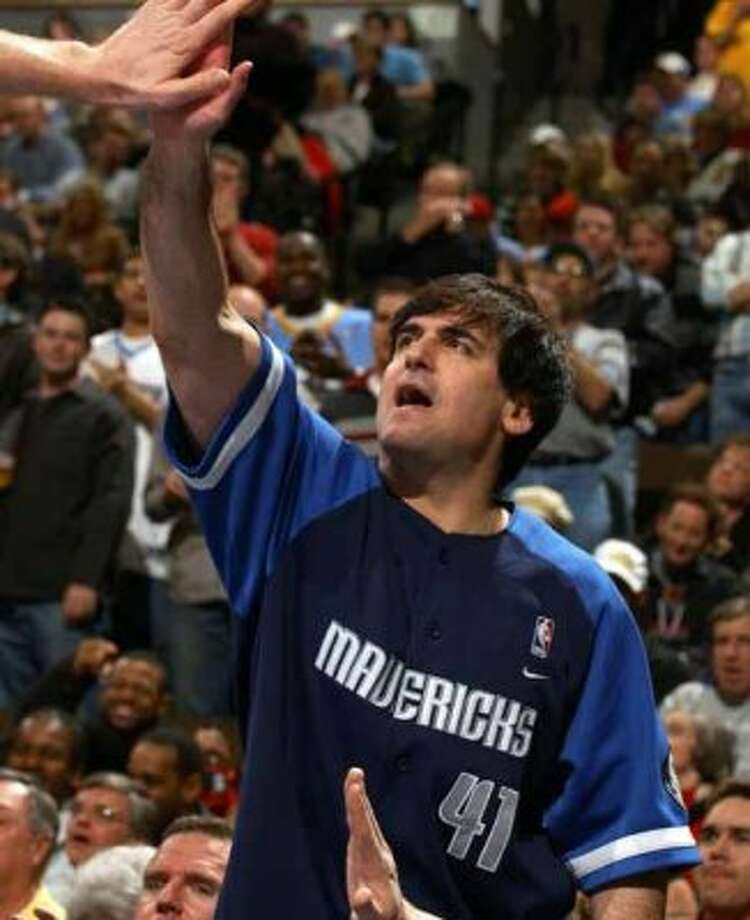 Dallas Mavericks owner Mark Cuban, reaches up to congratulate center Shawn Bradley as Bradley returns to the bench during the fourth quarter of the Mavericks' 91-88 victory over the Nuggets in Denver on Friday, Jan. 16, 2004. (AP Photo/David Zalubowski) (AP)