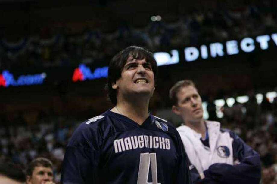 Dallas Mavericks owner Mark Cuban grimaces near the end of Game 6 against the Phoenix Suns in the teams' Western Conference semifinal series, in Dallas on Friday, May 20, 2005. Phoenix won 130-126, eliminated Dallas from the playoffs. (AP Photo/Tim Sharp) (AP)