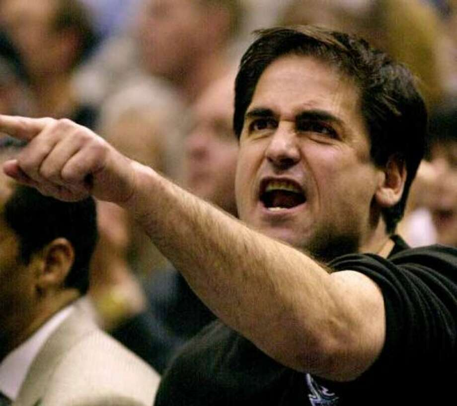 FILE -- Dallas Mavericks owner Mark Cuban exchanges words with one of the referees during the fourth quarter against the Utah Jazz in their first-round playoff game in Salt Lake City, in this April 14, 2001 photo. Cuban was fined $500,000 by the NBA on Tuesday Jan. 8, 2002 for repeated public criticism of game officials.   (AP Photo/Douglas C. Pizac) (AP)