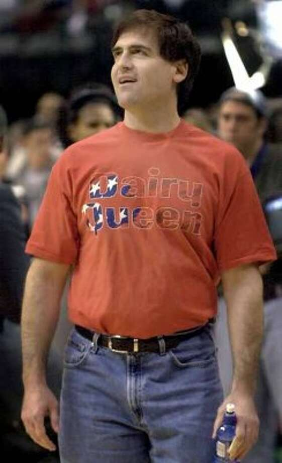 "Dallas Mavericks owner Mark Cuban sports a Dairy Queen t-shirt before the start of his team's game against the Indiana Pacers in Dallas, Saturday, Jan. 12,  2002.  Cuban, the billionaire owner of the Mavericks, just can't help himself when it comes to critiquing and criticizing NBA officials.  Nearly half his fine tally, $500,000, came last week for saying he wouldn't hire the league's head of referees ""to manage a Dairy Queen."" (AP Photo/LM Otero) (AP)"