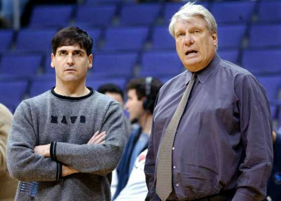 Dallas Mavericks owner Mark Cuban, left, and head coach Don Nelson talk during a pre-game shoot around against the Los Angeles Clippers Saturday, Jan. 26, 2002, at the Staples Center in Los Angeles. (AP Photo/Kevork Djansezian) (AP)