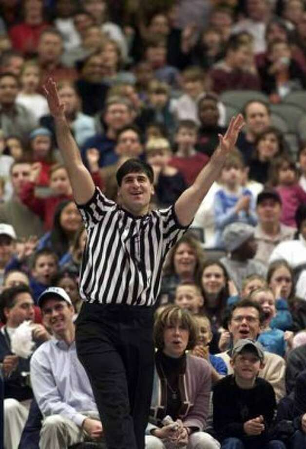 "Dallas Mavericks owner Mark Cuban referees the first half of a Harlem Globetrotters game Friday, Feb. 1, 2002, in Dallas. He had so much fun, he stretched his scheduled five minutes into 20. ""I had a blast,"" Cuban said, his brow sweaty and his zebra shirt autographed by the entire Globetrotters team. ""I found myself watching sometimes, enjoying it like I was 10 years old all over again."" (AP Photo/The Dallas Morning News, Michael Ainsworth) (AP)"