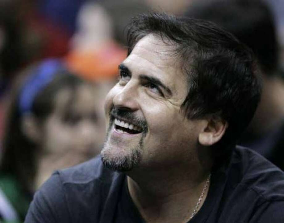 Dallas Mavericks owner Mark Cuban is all smiles as the Mavericks play against the Cleveland Cavaliers in the first quarter of an NBA basketball game, Wednesday, March 21, 2007, in Cleveland. The Mavericks won 98-90. (AP Photo/Tony Dejak) (AP)