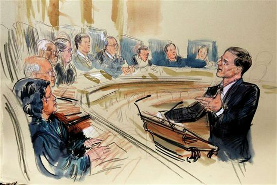 This artist rendering shows attorney Gregory G. Katsas speaking in front of the Supreme Court Justice in Washington, Monday, March 26, 2012, as the court began three days of arguments on the health care law signed by President Barack Obama in Washington. Justices seated, from left are, Sonia Sotomayor, Stephen Breyer, Clarence Thomas, Antonin Scalia, Chief Justice John Roberts and Anthony Kennedy, Ruth Bader Ginsburg, Samuel Alito and Elena Kagan. (Dana Verkouteren / The Associated Press) Photo: Dana Verkouteren, AP / AP