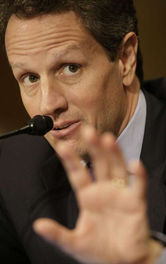 Treasury Secretary-designate Timothy Geithner gestures while testifying on Capitol Hill in Washington, Wednesday, Jan. 21, 2009, before the Senate Finance Committee hearing on his nomination. (AP Photo/Pablo Martinez Monsivais) Photo: Pablo Martinez Monsivais, AP