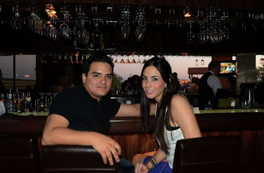 Isaac Ruiz and Mariana De Los Santos start their night at Bar 79 inside Perry's Steakhouse on March 24, 2012. Robin Johnson