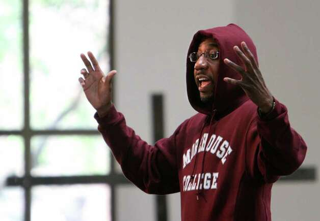 Rev. Raphael Warnock wears a hoodie during his morning sermon at the Ebenezer Baptist Church on Sunday, March 25, 2012, in Atlanta. Church-goers were invited to wear hoodies to services to show their support for justice in the case of Trayvon Martin, an unarmed black teenager who was wearing a hoodie on the night he was killed by a neighborhood watch captain in Florida. (AP Photo/Atlanta Journal-Constitution, Vino Wong)  MARIETTA DAILY OUT; GWINNETT DAILY POST OUT Photo: Vino Wong