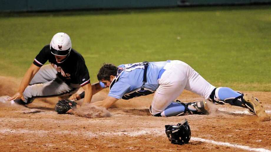 Johnson catcher Connor Roy hangs onto the ball after tagging out ChurchillÕs James Weeks trying to score. The Jaguars beat the Chargers, 8-5, in a battle of District 26-5A unbeaten teams. Photo: John Albright / For North Central News / John Albright / www.johnalbrightphoto.com