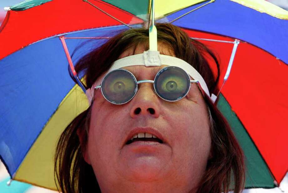 Vicki Marsh, of Melbourne, Fla., watches the Washington Nationals against the Houston Astros in a spring training baseball game in Viera, Fla., Monday, March 26, 2012. (AP Photo/Paul Sancya) Photo: Paul Sancya, Associated Press / AP