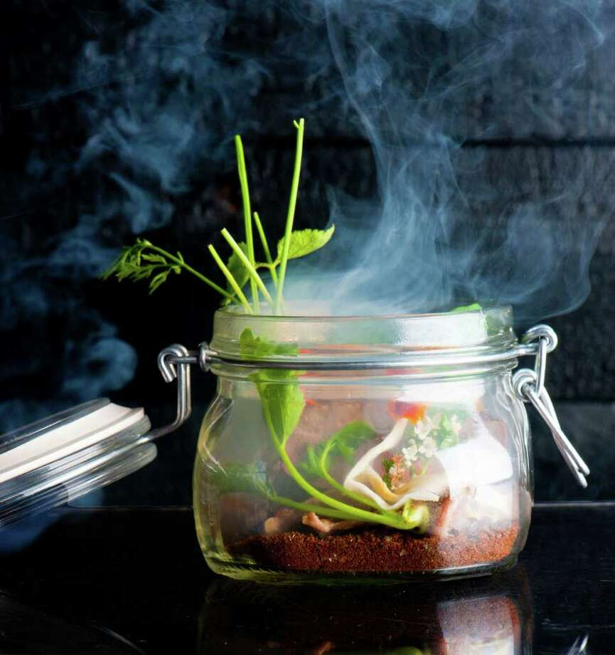 STEAM HEAT: Jar Jar Duck (duck in rosemary smoke with kumquat and endive in a jar) at Uchi Houston. Photo: Rebecca Fondren