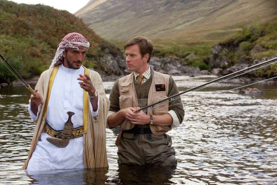 """In """"Salmon Fishing in the Yemen,"""" Ewan McGregor, right, plays a British fisheries expert who helps a Yemeni sheik (Amr Waked) stock a river with fish and introduce fishing to his c0untrymen. Photo: CBS Films / MCT"""