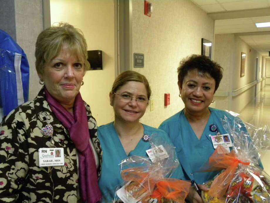 Celebrating Certified Nurses Day are Sarah Humme, chief nursing officer at Southwest General Hospital, and Maggie Muro and Merlyn Martin, certified registered nurses. Photo: Courtesy Photo