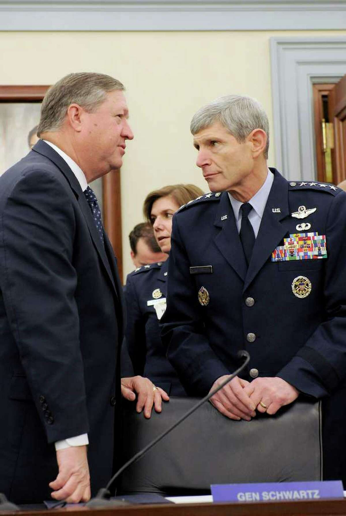 Secretary of the Air Force Michael Donley and Air Force Chief of Staff Gen. Norton Schwartz talk prior to a March 6th Air Force budget hearing before the U.S. House Appropriations Committee on Defense in Washington, D.C.
