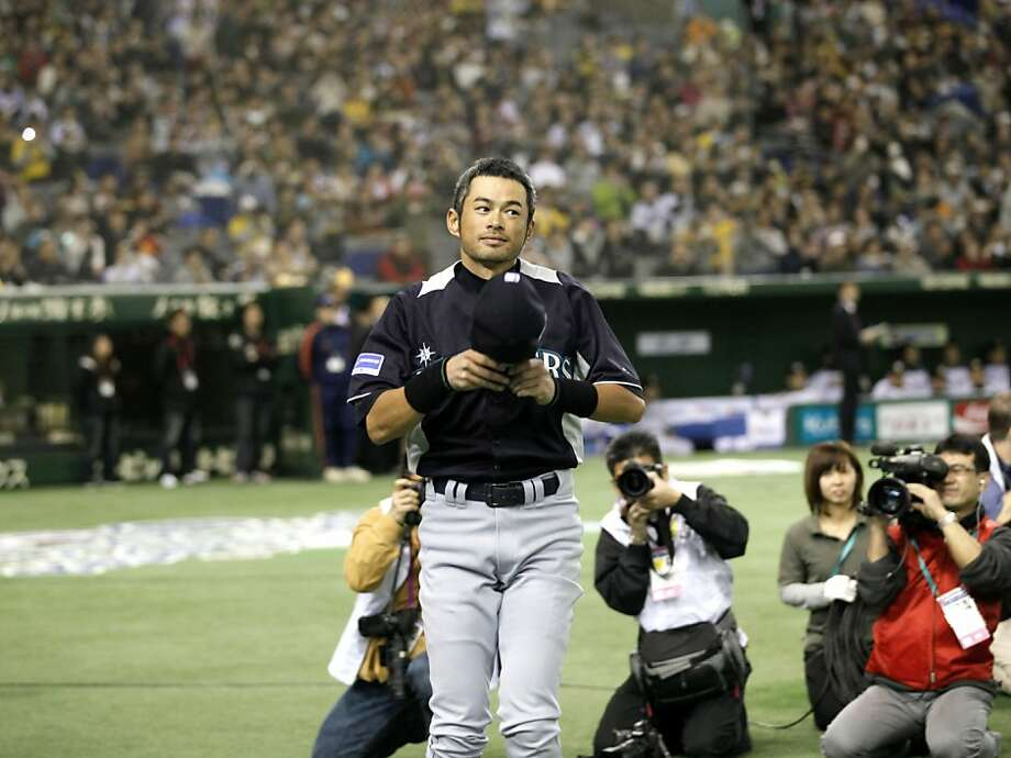 Seattle Mariners outfielders Ichiro Suzuki greets spectators during the opening ceremony of an  exhibition baseball game against Japan's Hanshin Tigers at the Tokyo Dome in Tokyo Sunday, March 25, 2012. The Mariners will meet the Oakland  Athletics in their two season-opening baseball games of the major league in Japan, at the Tokyo Dome from Wednesday.  (AP Photo/Koji Sasahara) Photo: Koji Sasahara, Associated Press