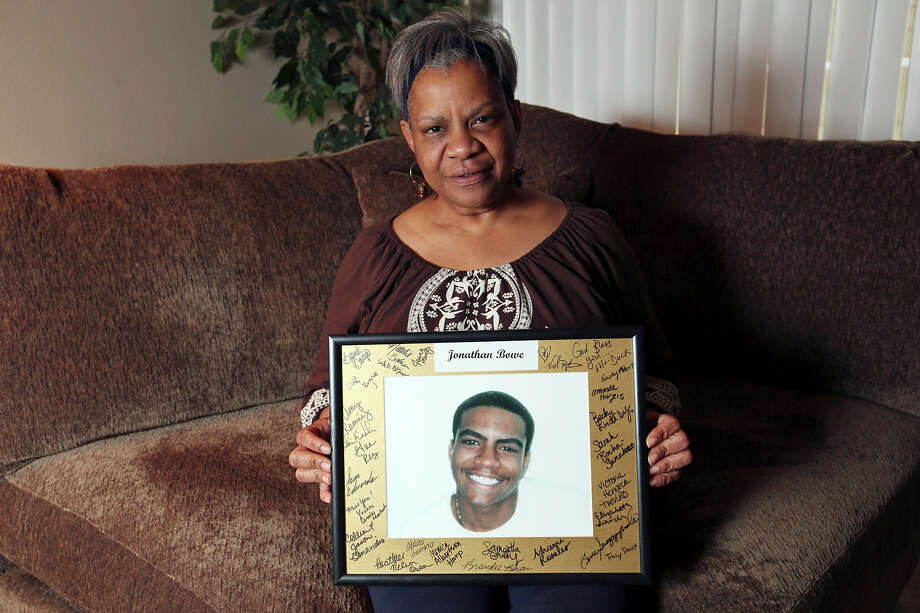 Kay Bowe, 55, sits with a portrait of her son Johnathan Bowe, who on April 5, 2005 was shot and killed in an apparent road rage incident at Loop 410 northbound access road near the Evers Road exit. Johnathan Bowe was 22. His unsolved homicide case is one of nine being featured in a weekly series by San Antonio police and Crime Stoppers. A reward of $10,000 is being offered through Sunday, 4/1/12, for any information leading to an arrest. Johnathan Bowe was driving his 2004 Kia Optima, his girlfriend was in the front passenger seat and two male friends were in the back seat. A driver in a truck pulled up on the passenger side of the KIA after the two vehicles nearly collided when the truck pulled out of a Wendy's onto the access road. The driver of the truck fired outside of his window into the passenger side window striking Bowe's girlfriend in the hand and Bowe in the arm and torso. He crashed into a tree in front of a house and died at the scene. Photo: EDWARD A. ORNELAS, SAN ANTONIO EXPRESS-NEWS / © SAN ANTONIO EXPRESS-NEWS (NFS)