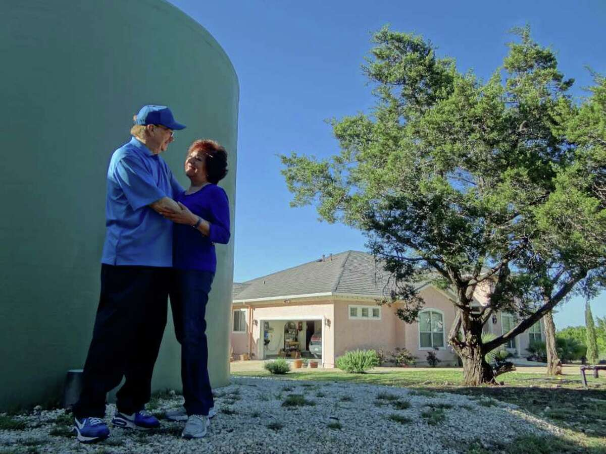 """Bobby and Martina Watson rely on a $30,000 rainwater collection system with two 10,000-gallon storage tanks at their home overlooking Canyon Lake. """"It's the best-tasting water available,"""" she says."""