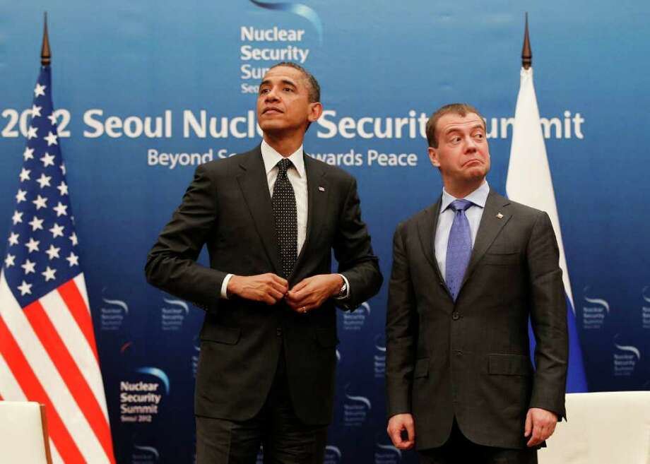 U.S. President Barack Obama (left) and Russian President Dmitry Medvedev stand together at the end of a bilateral meeting at the Nuclear Security Summit in Seoul, South Korea. Photo: Associated Press