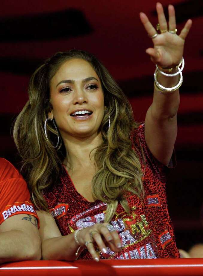 FILE - In this Feb. 19, 2012 file photo, singer and actress Jennifer Lopez waves to people as she watches carnival parades  at the Sambadrome in Rio de Janeiro, Brazil.  Lopez announced in a statement Monday that she would be performing at the Pop Music Festival in Sao Paulo on June 23 and in Rio De Janeiro on June 27. Photo: Victor R. Caivano