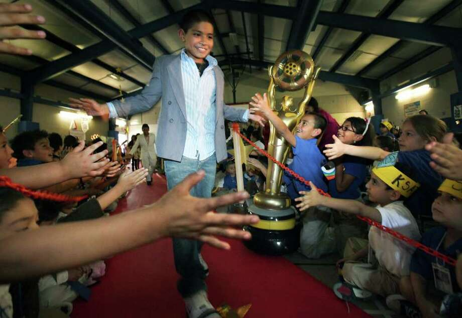 Joe Perez, a student at Collins Gardens Elementary School that will be taking the new STAAR test tomorrow, gets the red carpet treatment in the school's gym, as a motivational event to do well on the tests.  All students taking the test got the same celebration.  Monday, March 26, 2012.  Photo: BOB OWEN, San Antonio Express-News / © 2012 San Antonio Express-News