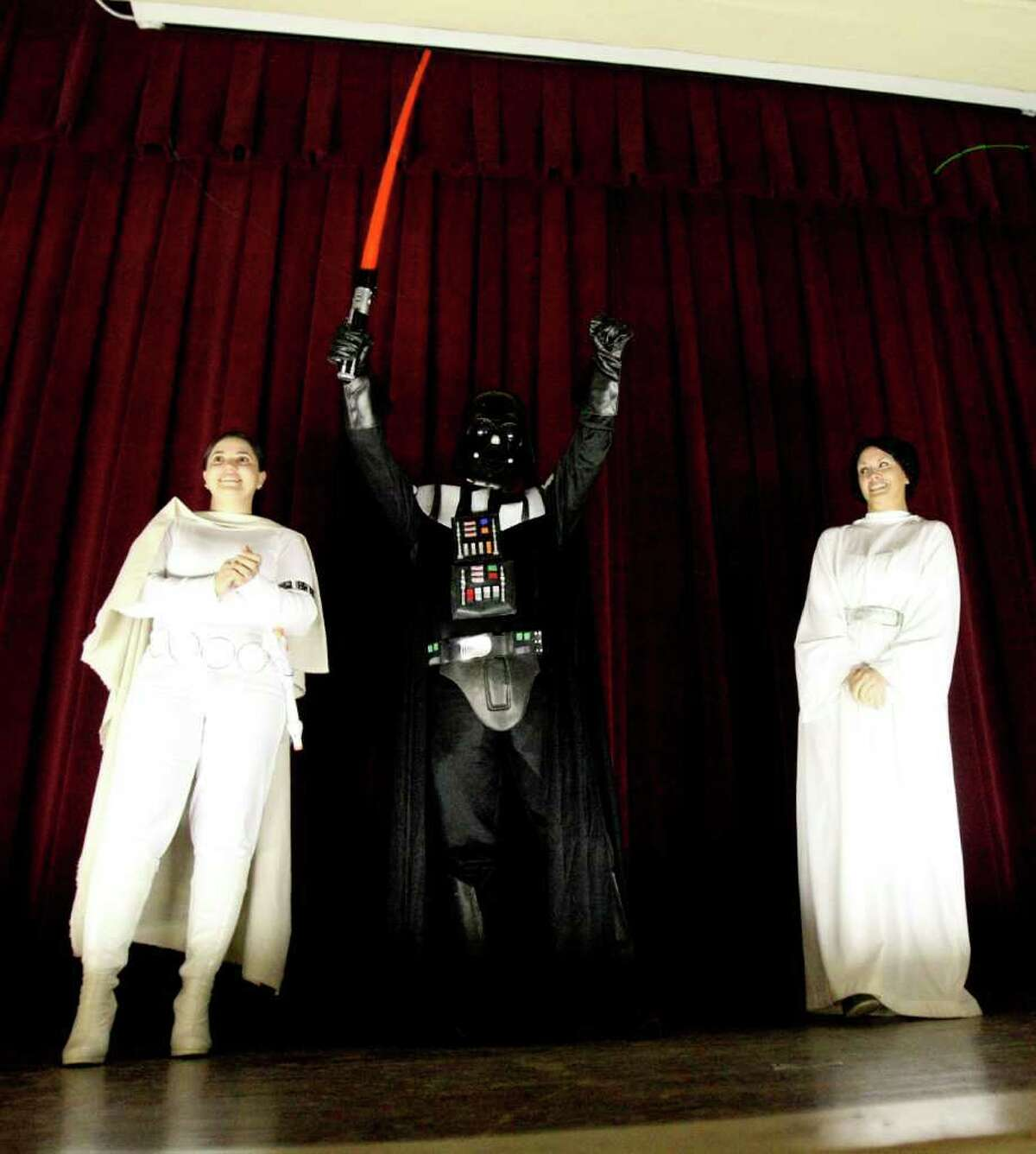 METRO: Rhodes Middle School teachers Rita Sanchez, Joshua Villarreal and Rickie Meredith dress as Star Wars characters during a STAAR Wars-themed rally on Monday March 26, 2012 to motivate students for the STAAR test this week.