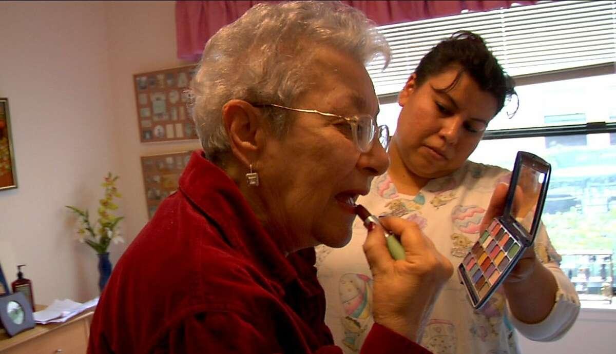 Lee Gorewitz applying lipstick in,