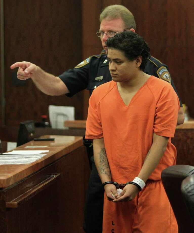 Luis Hector Lopez-Rodriguez, 27, who is a suspected drunk driver accused of crashing into a home killing one child and injuring another, is escorted from the 185th State District Court at the Harris County Criminal Courthouse, 1201 Franklin, Tuesday, March 20, 2012, in Houston.  He is accused of losing control of the car he was driving and plowing into the front porch of an apartment, where two children were playing during a Saturday night party. Jesus Ordonez, 7, was killed when the vehicle rammed into the front porch and Christopher Cruz, 4, was in critical condition with burns over 40 percent of his body. ( Melissa Phillip / Houston Chronicle ) Photo: Melissa Phillip / © 2012 Houston Chronicle
