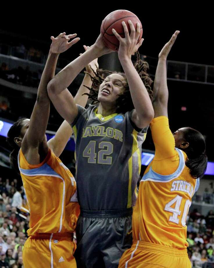 Tennessee's Vicki Baugh, left, and Shekinna Stricklen, right, defend Baylor's Brittney Griner during the first half of an NCAA women's college basketball tournament regional final, Monday, March 26, 2012, in Des Moines, Iowa. (AP Photo/Nati Harnik) Photo: Nati Harnik, Associated Press