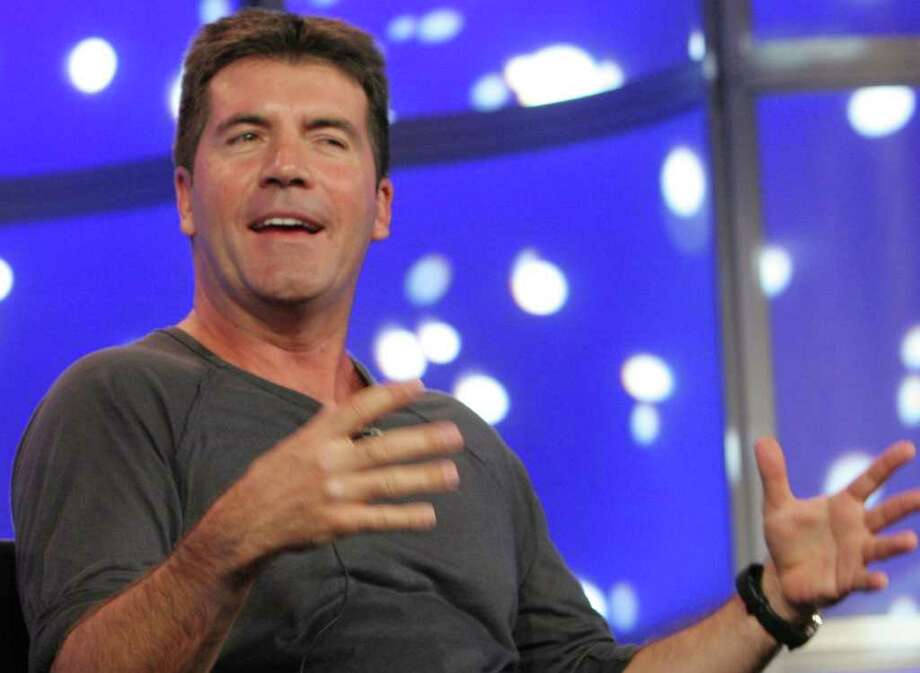 """Simon Cowell said he hid in his closetwhen a crazed fan allegedly broke into his London home and  wrote the words """"Help Me"""" in blood on one of his walls. Photo: RENE MACURA / AP"""