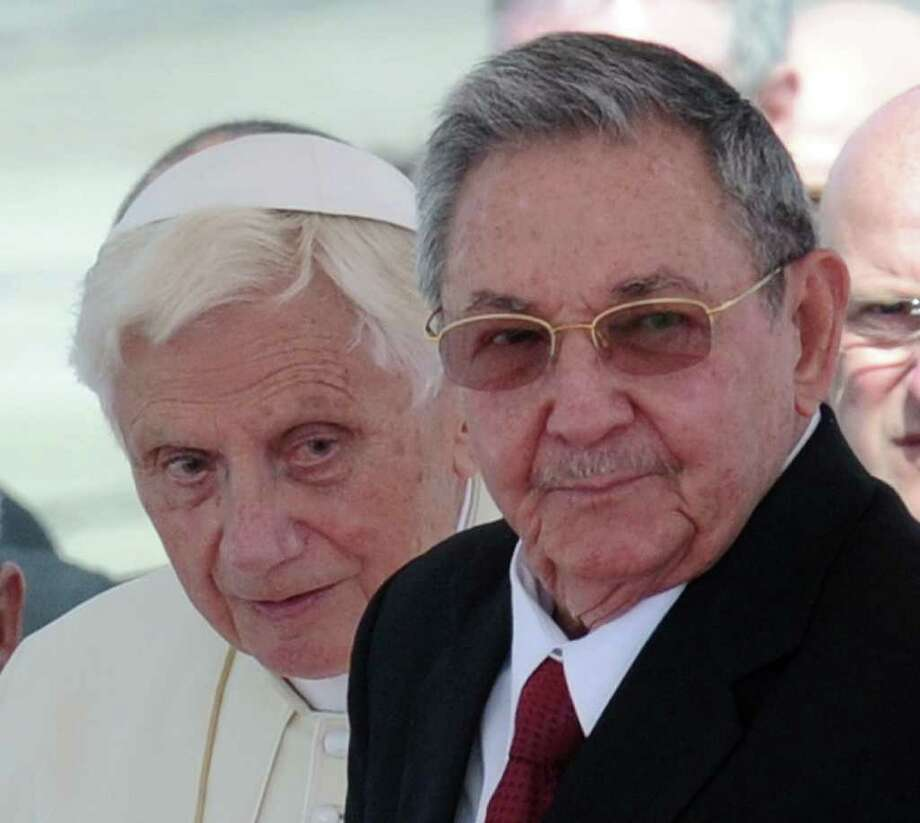 Pope Benedict XVI stands next to Cuban President Raul Castro (R) upon his arrival at Antonio Maceo international airport in Santiago de Cuba, 915 km southeast of Havana on March 26, 2012. Pope Benedict XVI arrived in Cuba seeking to boost his Church's special dialogue with the Communist regime, as dissidents said more than 150 people were arrested to derail protests. Photo: RODRIGO ARANGUA, AFP/Getty Images / AFP