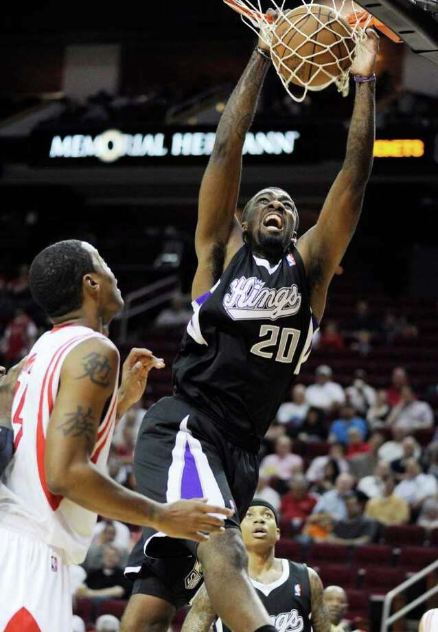 Sacramento Kings' Donte Greene (20) dunks the ball as Houston Rockets' Marcus Camby, left, looks on in the first half of an NBA basketball game Monday, March 26, 2012, in Houston. (AP Photo/Pat Sullivan) Photo: Pat Sullivan, Associated Press / AP