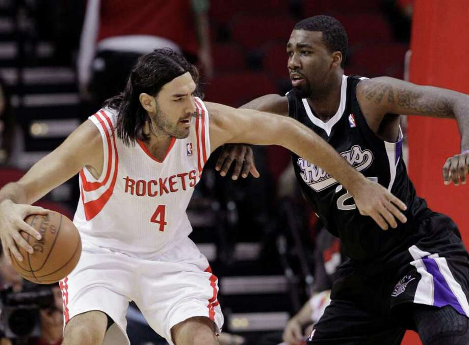 Houston Rockets' Luis Scola (4) tries to push past Sacramento Kings' Donte Greene in the first half of an NBA basketball game Monday, March 26, 2012, in Houston. (AP Photo/Pat Sullivan) Photo: Pat Sullivan, Associated Press / AP