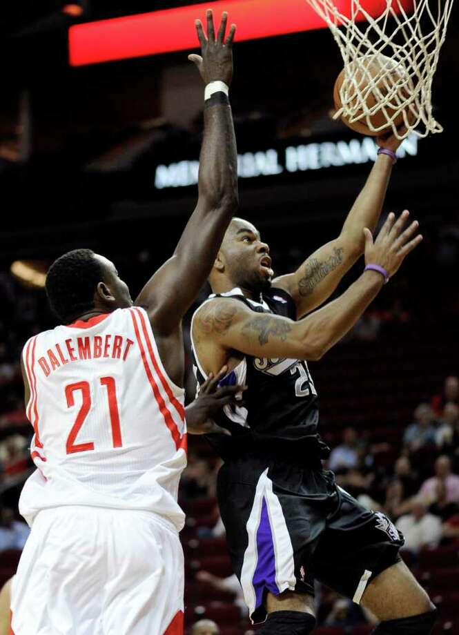 Sacramento Kings' Marcus Thornton, right, goes up for two points against Houston Rockets' Samuel Dalembert (21) in the first half of an NBA basketball game Monday, March 26, 2012, in Houston. (AP Photo/Pat Sullivan) Photo: Pat Sullivan, Associated Press / AP