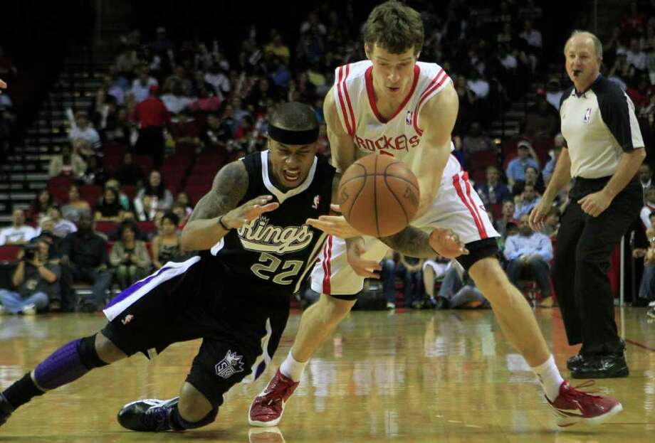 Sacramento Kings point guard Isaiah Thomas, 22, knocks the ball lose from Houston Rockets point guard Goran Dragic (3) during the first half of a basketball game at the Toyota Center Monday, March 26, 2012, in Houston. Photo: Cody Duty, Houston Chronicle / © 2011 Houston Chronicle