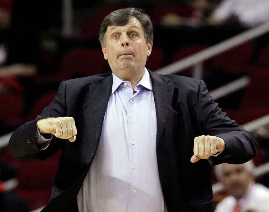 Houston Rockets coach Kevin McHale signals his players in the first half of an NBA basketball game against the Sacramento Kings Monday, March 26, 2012, in Houston. (AP Photo/Pat Sullivan) Photo: Pat Sullivan, Associated Press / AP