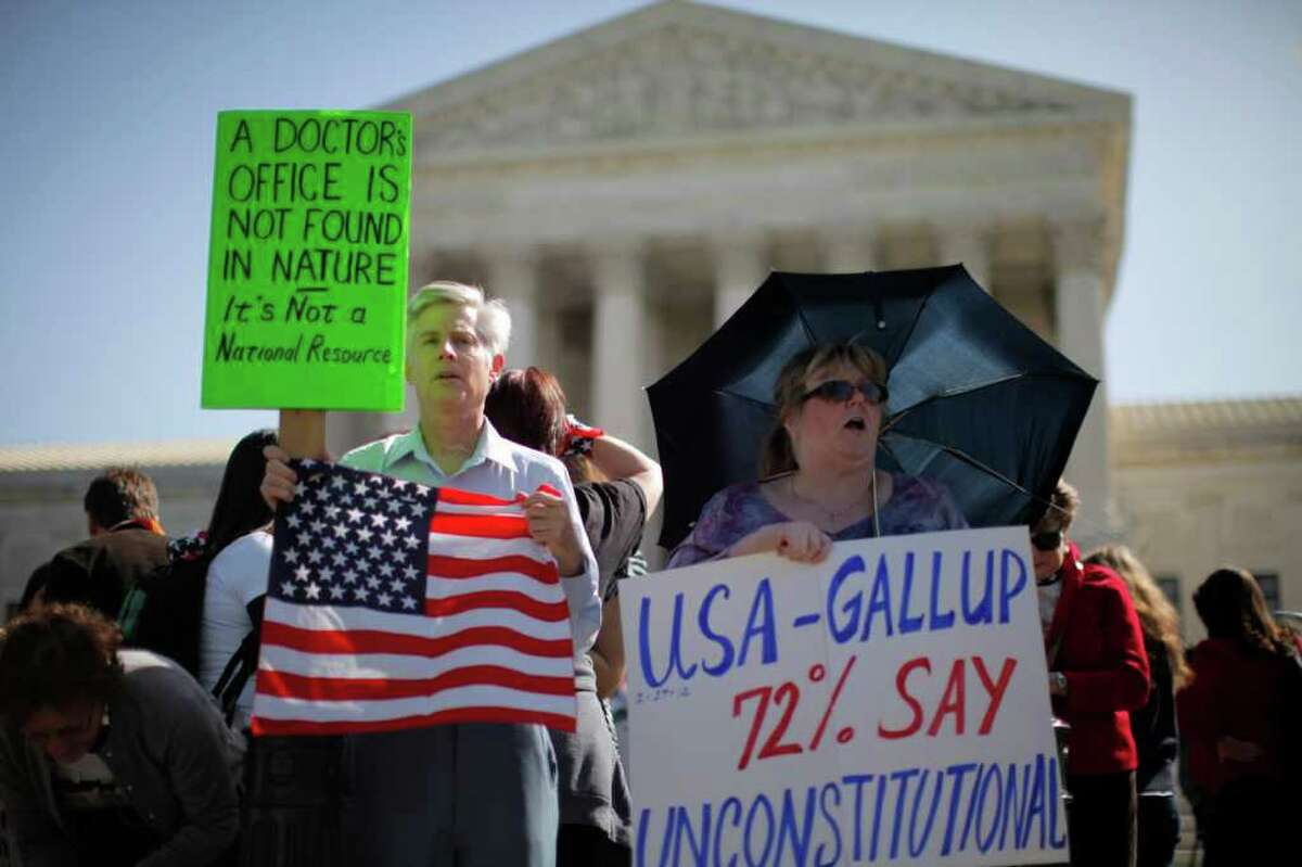 Opponents of President Barack Obama's health care law rally in front of the Supreme Court last week. Republican leaders are optimistic that the law will be defeated, but analysts differ on what the political consequences will be.