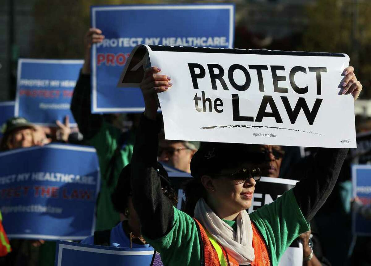People backing the health care reform law - the Patient Protection and Affordable Care Act - march outside the U.S. Supreme Court on Monday.
