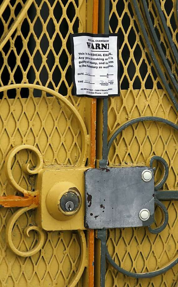 A medical examiner sticker seals the front door of 16 Howth Street, the site of a quintuple murder, on Monday, March 26, 2012 in San Francisco, Calif. Photo: Beck Diefenbach, Special To The Chronicle